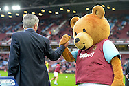 Jose Mourinho, the Chelsea manager is greeted by the West Ham Bubbles The Bear Mascot before k/o.  Barclays Premier League, West Ham Utd v Chelsea at The Boleyn Ground, Upton Park in London on Saturday 24th October 2015.<br /> pic by John Patrick Fletcher, Andrew Orchard sports photography.