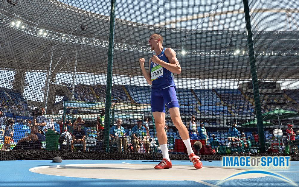 Aug 18, 2016; Rio de Janeiro, Brazil; Zach Ziemek (USA) reacts during the men's decathlon discus in the Rio 2016 Summer Olympic Games at Estadio Olimpico Joao Havelange.