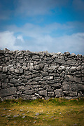 The walls of the imposing Dun Aengus Stone Fort, Inishmore, the Aran Islands, off Ireland's west coast. The fort is preched on a windswept 100-metre high cliff above the Atlantic waves. Thought to date to the 2nd century BC,  it is surrounded by cheval de frise defences.