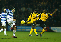 Photo. Chris Ratcliffe<br /> QPR v Rushden & Diamonds. Nationwide Division 2. 03/01/2004<br /> Marc Bircham of QPR and Rodney Jack of Rushden tangle for the ball.