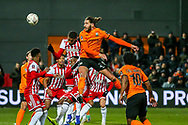 Barnet defender Dan Sweeney (26) heads towards goal during the The FA Cup fourth round match between Barnet and Brentford at The Hive Stadium, London, England on 28 January 2019.