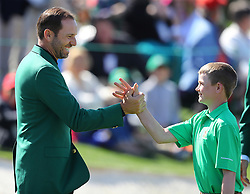 April 1, 2018 - Augusta, GA, USA - Defending Masters champion Sergio Garcia gives Nicholas Gross, Downington, Pa/, five after his putt on the 18th green to win the putting championship for 10-11 boys during the Drive Chip Putt National Finals on Sunday, April 1, 2018 at Augusta National Golf Club in Augusta, Ga. (Credit Image: © Curtis Compton/TNS via ZUMA Wire)