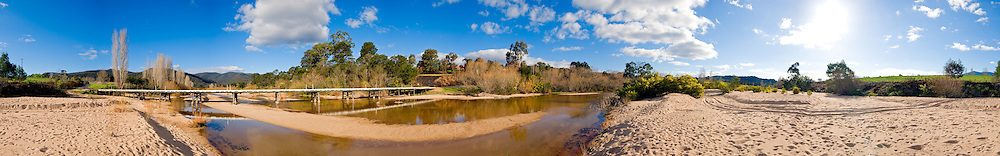 Bridge over a very low river in Towamba, New South Wales, Australia. High resolution panorama.