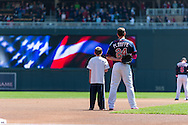 Trevor Plouffe #24 of the Minnesota Twins stands with a young fan during the national anthem before a game against the Baltimore Orioles on May 12, 2013 at Target Field in Minneapolis, Minnesota.  The Orioles defeated the Twins 6 to 0.  Photo: Ben Krause