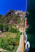 A Chihuahua al Pacifico Railroad train (Chepe)  crossing the Santa Barbara Bridge, near Temoris, en route  from El Fuerte to the Copper Canyon, Mexico