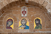 Ancient port of Jaffa, Israel pictures of Saints in the Greek Orthodox monastery wall