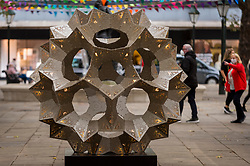 "© Licensed to London News Pictures. 30/09/2020. LONDON, UK. A complex stellated polyhedral called ""In Bloom"" by London-based design collective Toy Studio has been installed in Sloane Square as part of Kensington and Chelsea Art Week's Public Art Trail.  These and other temporary landmarks have been installed across eight zones of the borough, connecting the Royal Borough of Kensington and Chelsea, providing a walking trail for the public to enjoy.  The event runs 1 October to 11 October 2020.  Photo credit: Stephen Chung/LNP"