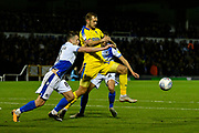 James Hanson (18) of AFC Wimbledon battles for possession with Ollie Clarke (8) of Bristol Rovers and Edward Upson (6) of Bristol Rovers during the EFL Sky Bet League 1 match between Bristol Rovers and AFC Wimbledon at the Memorial Stadium, Bristol, England on 23 October 2018.