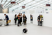 New York, NY - 5 May 2017. The opening day of the Frieze Art Fair, showcasing modern and contemporary art presented by galleries from around the world, on Randall's Island in New York City. An installation of drums, one on it's side, the others suspended upside down, which appear to play themselves, by Anri Sala, in the Marian Goodman Gallery.