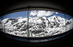THEMENBILD - die Grossglockner Hochalpenstrasse. Die hochalpine Gebirgsstrasse verbindet die beiden oesterreichischen Bundeslaender Salzburg und Kaernten mit einer Laenge von 48 Kilometer. Sie ist als Erlebnisstrasse vorrangig von touristischer Bedeutung und das Befahren ist fuer Kraftfahrzeuge mautpflichtig, im Bild Blick auf den Grossglockner und das Glocknermassiv durch eine Glasfassade des Besucherzentrums auf der Kaiser-Franz-Josefs-Höhe, aufgenommen am 24.05.2014 // ILLUSTRATION - the Grossglockner High Alpine Road. The high alpine mountain road connects the two Austrian federal states of Salzburg and Carinthia with a length of 48 kilometers. It is as a matter of priority road experience of tourist importance and for driving motor vehicles is a toll road. Picture taken on 2014/05/24. EXPA Pictures © 2014, PhotoCredit: EXPA/ JFK