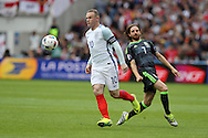 Wayne Rooney of England breaks away from Joe Allen of Wales.  UEFA Euro 2016, group B , England v Wales at Stade Bollaert -Delelis  in Lens, France on Thursday 16th June 2016, pic by  Andrew Orchard, Andrew Orchard sports photography.