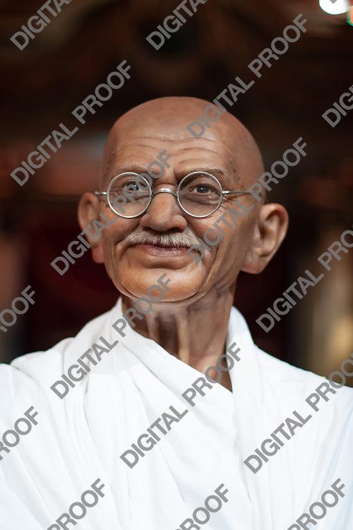 Portrait of Mahatma Gandhi wax figure in display museum Grevin in Paris, France