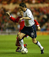 Photo. Andrew Unwin.<br /> Middlesbrough v Tottenham Hotspurs, Barclaycard Premier League, Riverside Stadium, Middlesbrough 09/03/2004.<br /> Middlesbrough's Gaizka Mendieta (l) looks to tackle Tottenham's Robbie Keane (r).