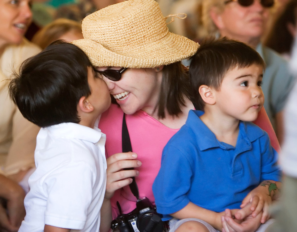 LITCHFIELD, CT- 24 JUNE 2007- 062407JT05-.Caleb Parilla, 5, of Litchfield, presses noses with his mother Rebecca as she holds his brother Noah, 3, in the audience during a program about birds of prey with Brian Bradley at the Livingston Ripley Waterfowl Sanctuary in Litchfield for the sanctuary's second annual Duck Day on Sunday, June 24..Josalee Thrift Republican-American