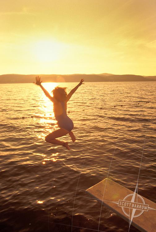 Young Girl Jumping into Lake.