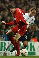 Photo. Daniel Hambury.<br /> Carling Cup.<br /> Tottenham Hotspur v Liverpool. 1/12/2004.<br /> Spur's Reto Ziegler and Liverpool's David Raven