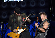 Three Days Grace guitarist Barry Stock, left, and bassist Brad Walst, right, perform Feb. 25, 2019, at Madison Square Garden in New York City.