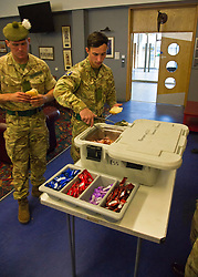 Pictured: Fusiler Louise Gibb prepares a welcome bacon buttie<br /> <br /> 2 SCOTS arriving home from Iraq deployment. OP Shader troops from The Royal Highland Fusiliers, 2nd Battalion The Royal Regiment of Scotland have been training local forces since December 2017. The troops have been training the local Iraqi forces for the last six months<br /> <br /> <br /> Ger Harley | EEm 19 June 2018