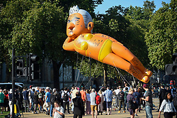 "© Licensed to London News Pictures. 01/09/2018. LONDON, UK.  A 29 foot giant balloon depicting Sadiq Khan, Mayor of London, wearing a yellow bikini, flies over Parliament Square.  Activist Yanny Bruere raised £58,000 to fly the balloon in protest at the Mayor's decision to allow a giant balloon of Donald Trump as a baby to be flown during his visit to the UK.  The Sadiq Khan balloon is part of Mr Buere's ""Make London Safe Again"" campaign, a reference to a surge in violent crime in London and Mr Trump's slogan ""Make America Safe Again"".  Photo credit: Stephen Chung/LNP"