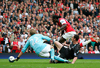 Photo: Tom Dulat.<br /> Arsenal v Bolton Wanderers. The FA Barclays Premiership. 20/10/2007.<br /> Andrew O'brien of Bolton Wanderers managed to stop racing  Emmanuel Adebayor of Arsenal. Goalkeeper of Bolton Jussi Jaaskelainen