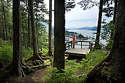 USA, Alaska, A traveler looks over the town of Wrangell from the Mount Dewey Overlook.