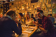 Wine director Richard Cappiello, in the plaid shirt, discussing the wine with a table of diners.