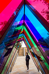 © Licensed to London News Pictures. 30/09/2020. LONDON, UK. A six-metre long triangular prism corridor of light and colour by Liz West has been installed in Duke of York Square near Sloane Square as part of Kensington and Chelsea Art Week's Public Art Trail.  These and other temporary landmarks have been installed across eight zones of the borough, connecting the Royal Borough of Kensington and Chelsea, providing a walking trail for the public to enjoy.  The event runs 1 October to 11 October 2020.  Photo credit: Stephen Chung/LNP
