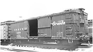 """Box car #3256 at Alamosa yard.<br /> D&RGW  Alamosa, CO  Taken by Ward, Bert H. - 7/10/1946<br /> In book """"Narrow Gauge Pictorial, Vol. III: Gondolas, Boxcars and Flatcars of the D&RGW"""" page 120"""