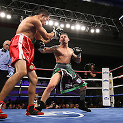 """Orlando Cruz, (green trunks)  fights against Jorge Pazos at the Kissimmee Civic Center in Kissimmee, Florida, on Friday, October 19, 2012. The Puerto Rican Cruz recently described himself as """"a proud gay man"""" and the first active boxer having pronounced so, in boxing history.  Cruz won the fight via 12 round decision. (AP Photo/Alex Menendez)"""