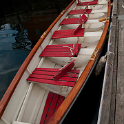 Fixed seat single oar wooden rowing craft at the Gloucester Maritime Heritage Center.