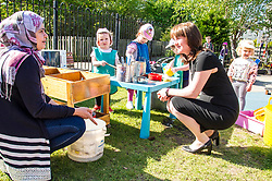 Pictured: Maree Todd chatted to Shazia Akbar, Nursery team leader while some of the children including Skye (3 green tabard), Zuzanna (3 Dora hat); Olivia (2 Blue t-shirt) and Harriet (3 green hat) prepared some refreshments.<br /> <br /> The Minister for Childcare and Early Years, Maree Todd visited North Edinburgh Childcare and Training centre today and welcomed the childcare deposit pilot. Ms Todd met staff and children at the centre to discuss the pilot.<br /> <br /> Ger Harley | Edinburgh Elite Media