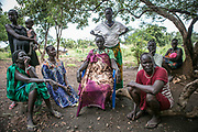 Nuer women survivors of sexual violence by Dinka soldiers in South Sudan sit in their communal area inside Bidibidi refugee settlement in northern Uganda. Some of them live with the children who were born as a result of a gang-rape and all of their husbands were either killed or missing. The brutal civil war in South Sudan in both 2013 and 2017 have prompted a massive upsurge of sexual violence, as the country's Nuer and Dinka tribes seek to dominate and humiliate one another.