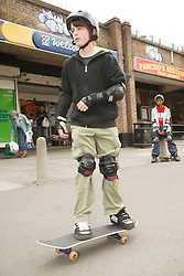 Young people skateboarding.