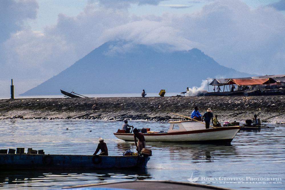 Indonesia, Sulawesi, Manado. Manado harbour with Manado Tua, an extinct volcano, in the background.