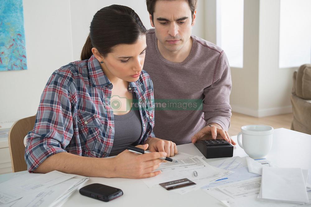 Couple looking at home finances (Credit Image: © Image Source/ZUMAPRESS.com)