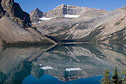 Mountains of the Waputik Range with glaciers reflected in the waters of Hector Lake.Banff National Park, Canada..
