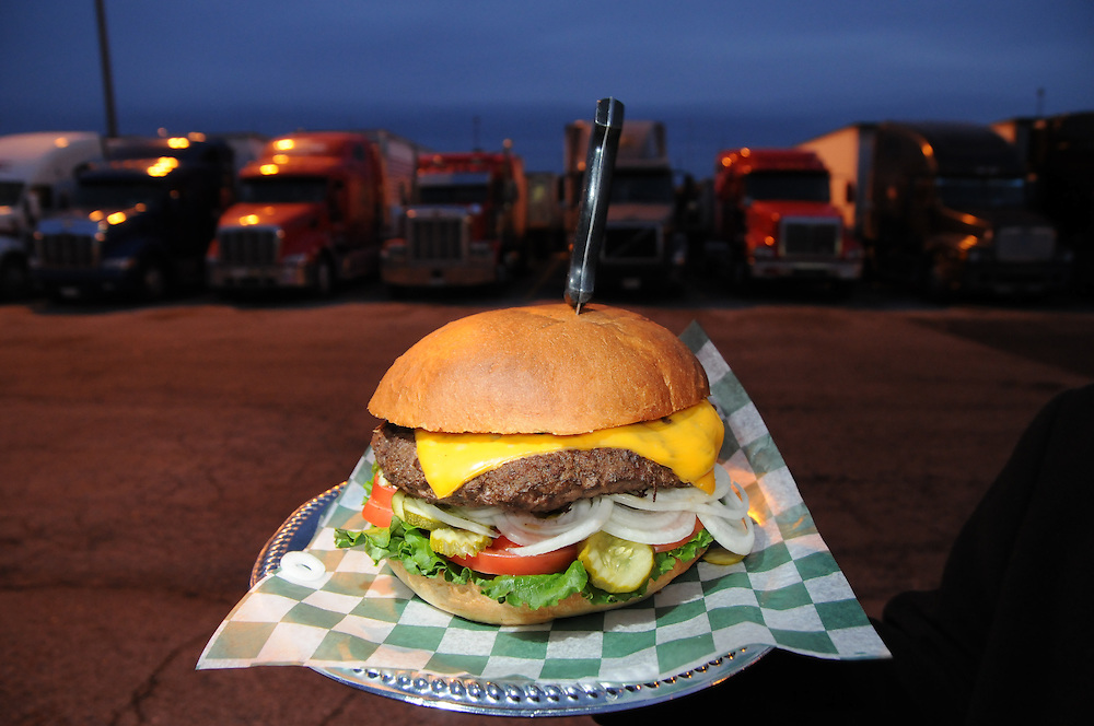 """The """"Premium Ethyl Burger"""" from """"R"""" Place restaurant at the TA Travel Centers of America in Morris, Illinois is free if eaten in less than 10 minutes. All who make the attempt at the four pound whopper earn their place among past challengers with a their photo on the wall. Winners are posted on a separate display."""