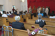 """The Chosen Few, an all-male gospel quartet, fill the chapel with """"Lord Show Me The Way,"""" during a joining ceremony at the First Church of American Slaves, Saturday, Sept. 17, 2011 in Louisville, Ky. (Photo by Brian Bohannon)"""