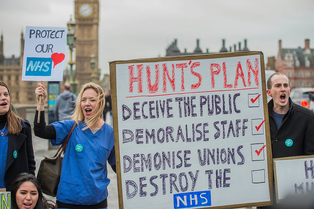 Desiree Crainborough (R), a nursery outreach worker, and her mother lend their support - The picket line at St Thomas' Hospital. The second official junior doctors strike started at 8 AM this morning against proposals by the government.