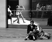 Waiting - family of 3 waiting in contrast to motion - black and white image