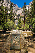 Interpretive plaque at the site of John Muir's cabin below Yosemite Falls, Yosemite National Park, California USA