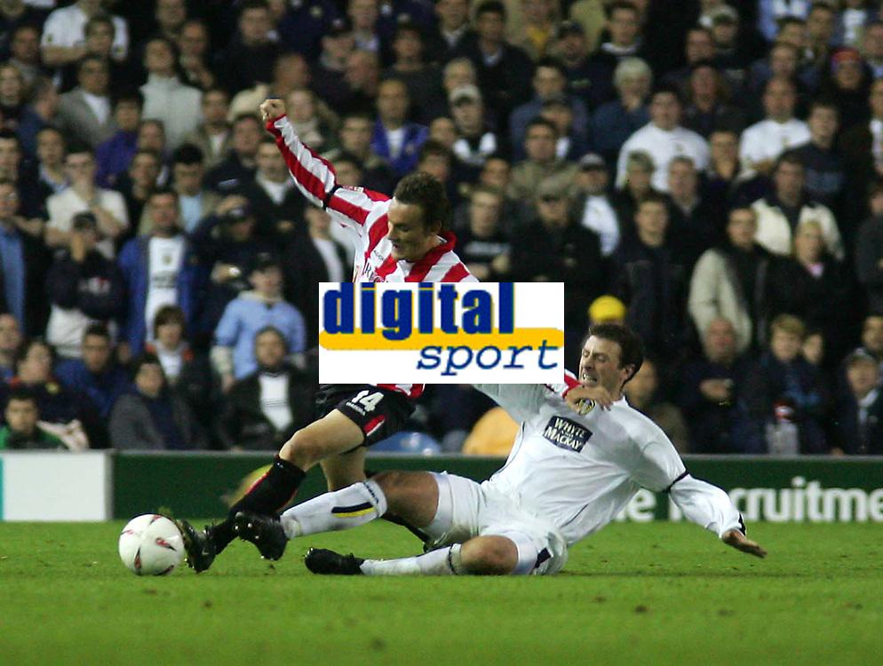Fotball<br /> England<br /> 24.09.2004<br /> Foto: SBI/Digitalsport<br /> NORWAY ONLY<br /> <br /> Leeds United v Sunderland<br /> Coca-Cola Championship<br /> Elland Road<br /> <br /> Leeds' Sean Gregan (R) slides in from behind on Sunderland's Dean Whitehead (L).