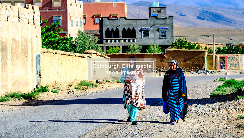 Two young women in traditional dress walking in the village of Tamtetoucht at the foot of the High Atlas in Morocco<br /> <br /> (c) Andrew Wilson   Edinburgh Elite media