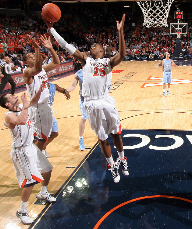 Virginia Cavaliers forward Akil Mitchell (25) reaches for a rebound during the game against North Carolina in Charlottesville, Va. North Carolina defeated Virginia 54-51.