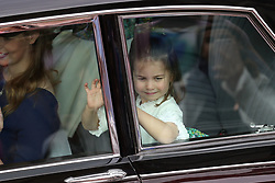 Bridesmaid Princess Charlotte (right) and Lady Louise Mountbatten-Windsor arrive for the wedding of Princess Eugenie to Jack Brooksbank at St George's Chapel in Windsor Castle.