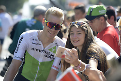July 24, 2018 - Bagneres De Luchon, FRANCE - Belgian Julien Vermote of Dimension Data poses for a fan who takes a selfie picture with her smart phone camera, at the start of the 16th stage of the 105th edition of the Tour de France cycling race, 218km from Carcassone to Bagneres-de-Luchon, France, Tuesday 24 July 2018. This year's Tour de France takes place from July 7th to July 29th...BELGA PHOTO YORICK JANSENS - FRANCE OUT (Credit Image: © Yorick Jansens/Belga via ZUMA Press)