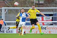 Chesham United defender Nick Beasant tries to beat Bristol Rovers striker Matt Taylor to the ball during the The FA Cup match between Bristol Rovers and Chesham FC at the Memorial Stadium, Bristol, England on 8 November 2015. Photo by Alan Franklin.