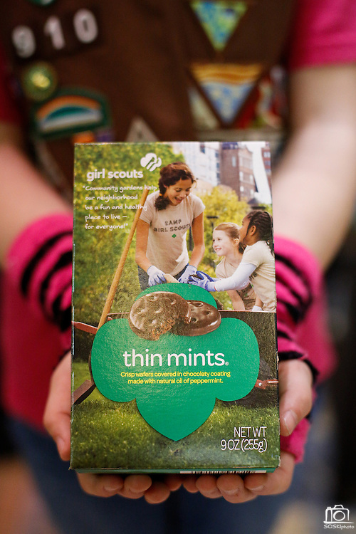 Mary Curran of Northeast Texas Girl Scouts Troop 910 holds a box of Thin Mints to display the new box design at the Girl Scouts of Northeast Texas.headquarters in Dallas, Texas, on January 10, 2013.  (Stan Olszewski/The Dallas Morning News)