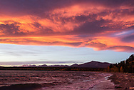 Clouds catch morning light as a high winds roll over Naknek Lake, Alaska