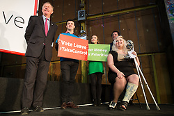 """© Licensed to London News Pictures . 15/04/2016 . Manchester , UK . People on stage greet Boris Johnson as he arrives to speak at a """" Vote Leave """" rally at Old Granada Studios , in Manchester . Photo credit: Joel Goodman/LNP"""